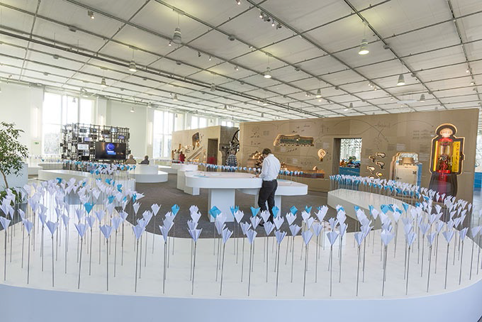 Flower bed of paper flowers at exhibition entrance